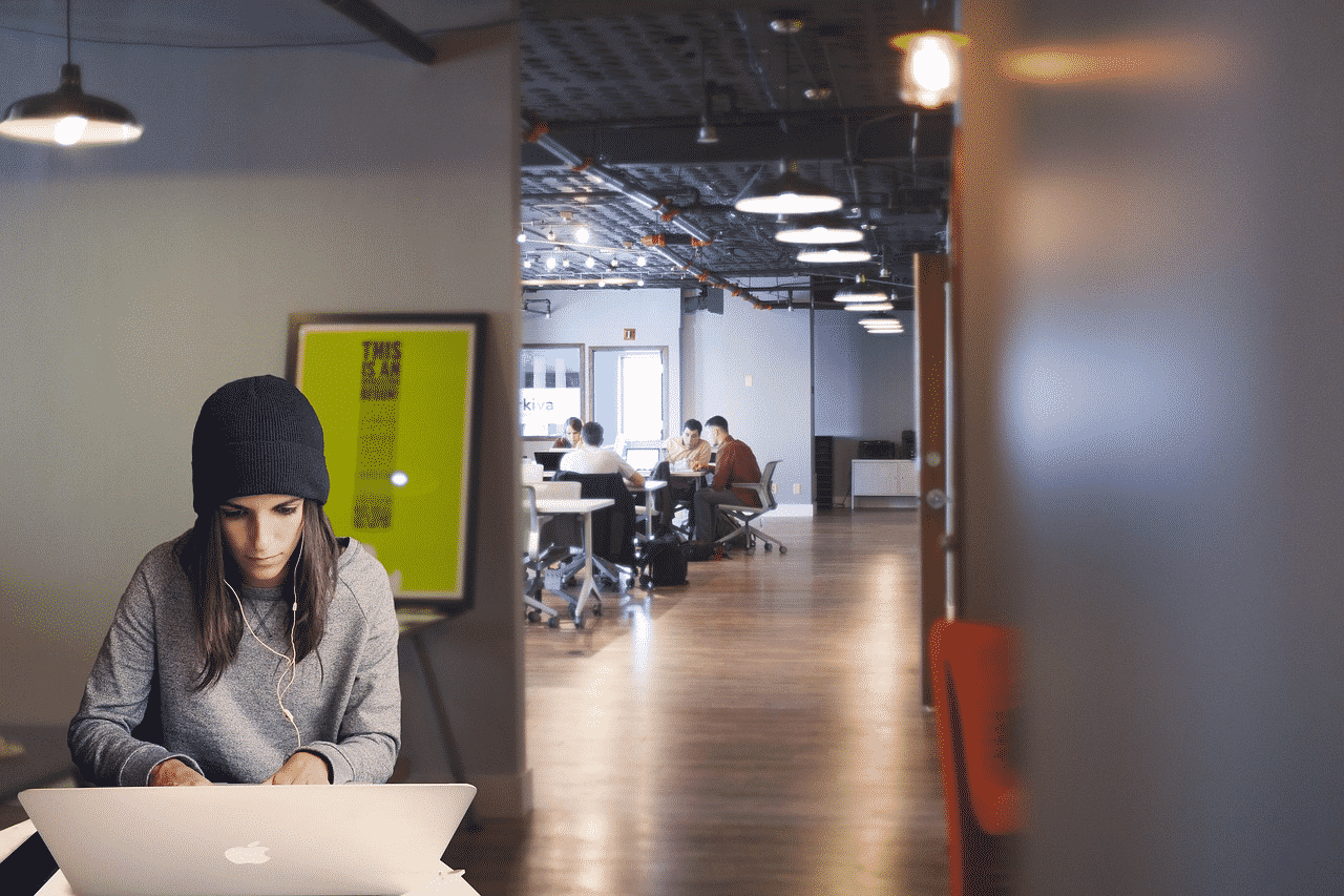 women working alone in coworking space