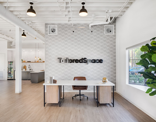 tailoredspace office environment with logo